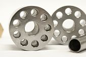 Metal Flanges And Cylinders.  Milling Industry. Close-up.