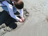 picture of clam digging  - Digging for clams on a warm summer day - JPG