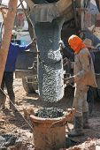 Construction Worker Controlling Pile Form Filling With Continuous Concrete Casting
