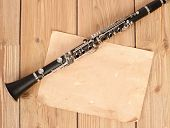 clarinet and blank paper in wood background