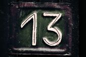 Dark Grungy plate with number thirteen
