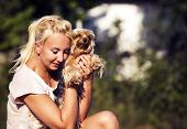 Young Beautiful Woman With Yorkshire Terrier, Against Summer Park.
