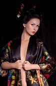 picture of geisha  - Portrait of a Japanese geisha woman in black kimano - JPG