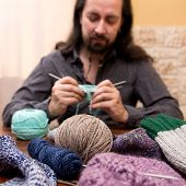 Knitting Man With Lot Of Wool