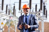 african industrial manager with binoculars in electricity power plant