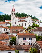 Mediterranean Town With A Church On Top Of A Hill In Southern Dalmatia