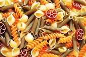 Background Of Different Flavored Pasta Shapes