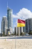 Surfers Paradise cityscape and beach with Red and Yellow Flag