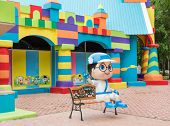 Colorful Toy Town Building With Coloful Blocks And A Boy Cartoon Character Greeting