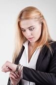 Beauty Blond Worried Female Manager Is Checking The Time