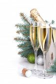 Champagne, blue firtree and christmas decor. Isolated on white background