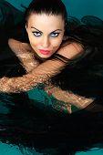 Beauty Face Woman in water