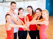 fitness, sport, training, success and lifestyle concept - group of happy people in the gym celebrati