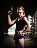 Young woman in uniform with gun (dark version)