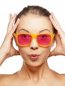 happiness, face expressions and people concept - portrait of surprised teenage girl in pink sunglass