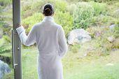 Rear view of a young woman wearing a bathrobe