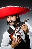 Mexican man with guitar in music concept