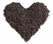 Tea love. Tea leaves in the form of heart isolated