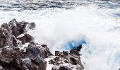 Coast With Stones Of Volcanic Flow And Ocean