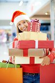 Young woman with gift boxes