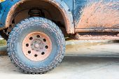 stock photo of four-wheel drive  - Muddy wheel - JPG