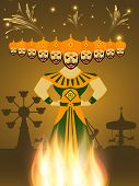 picture of dussehra  - View of a Dussehra fare with statue of Ravana with his ten heads burning in fire and silhouette of swings in fireworks night background - JPG