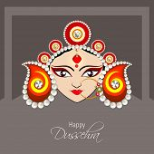 Illustration of the face of Goddess Durga with beautiful eyes wearing a golden nose ring and a heavy
