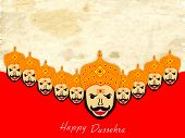 Proudly faces of Ravana on grungy brown and red background for Happy Dussehra festival.