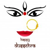Beautiful smiling face of Goddess Durga wearing nose ring on simple white background.