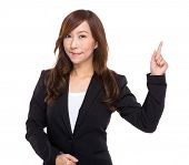 Middle age businesswoman with finger indicate something
