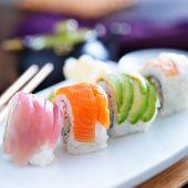 sushi rolls with salmon, tuna, avocado, and shrimp