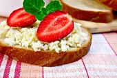 Bread With Curd And Strawberries On Red Fabric