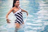 Brunette Girl In Swimming Suit