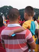 Asian Boy On Daddy's Shoulders