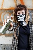 Female Hooligan Holding Graffiti Spray Can