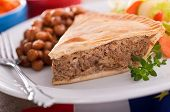 picture of acadian  - A slice of freshly baked Acadian meat pie with baked beans and garden salad.