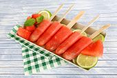 Watermelon ice-cream on wooden table, close-up