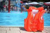 Orange Lifejacket Near Pool In Aquapark
