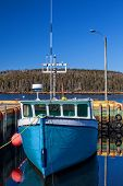 Fishing boat tied up at the wharf in rural Nova Scotia, Canada.