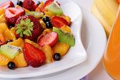 Fresh fruits salad on plate close up