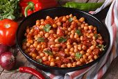 Chickpeas With Chorizo In A Frying Pan And The Ingredients