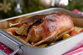 Duck stuffed with apples on a Christmas table