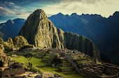 stock photo of lamas  - Machu Picchu at sunset when the sunlight makes everything golden - JPG