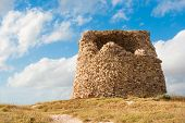 foto of megaliths  - watchtower on the coast of Sardinia made of megalithic style - JPG