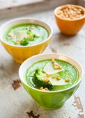 creamy broccoli soup with cheese and pine nut