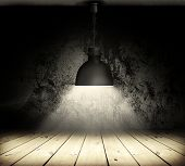 Black grunge wall and black plafond are lights wall and floor fom wooden boards