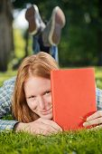 Student Holds A Red Book