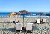 Wicker Umbrellas On The Beach
