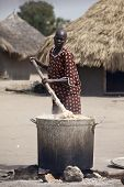 BOR, SOUTH SUDAN-DECEMBER 2: A unidentified woman prepares cassava in a large pot on December 2, 201