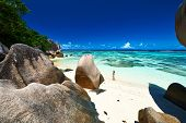 Woman at beautiful beach at Seychelles